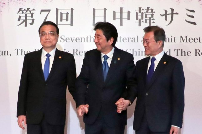 Leaders of Japan, South Korea and China met in Tokyo Wednesday for talks about the denuclearization of the Korean Peninsula. File Photo by Yonhap