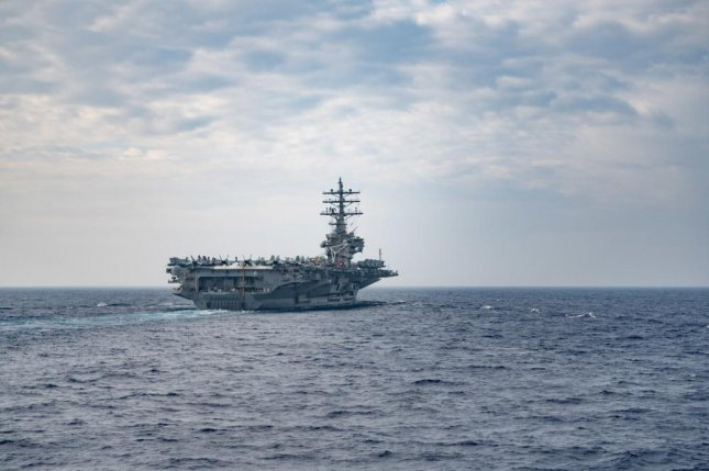 The Nimitz class aircraft carrier USS Ronald Reagan, shown here in the Philippine Sea in May, entered the South China Sea this week. Photo by Samuel Hardgrove/U.S. Navy
