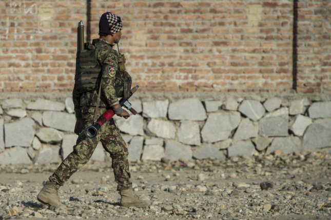 Harris Corp. has been awarded a $1.7 billion U.S. Army contract to supply Afghanistan with radios, ancillaries, spare parts and services. An Afghan soldier is shown here patrolling earlier this year. U.S. Army photo by Staff. Sgt. Corey Hook