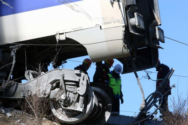 Workers inspect a KTX bullet train after it derailed in Gangneung, South Korea, on Saturday. Photo by Yonhap/EPA-EFE