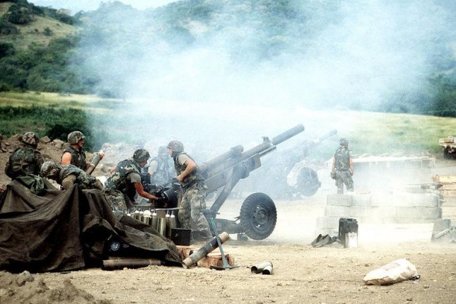 The 82nd Airborne artillery personnel loads and fires M102 105 mm howitzers during Operation Urgent Fury on November 3, 1983. Photo courtesy of U.S. Army via Wikipedia