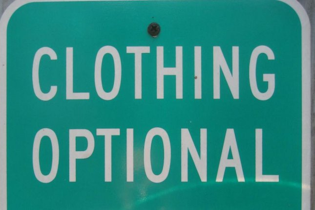 A clothing optional sign at a nudist beach. (CC/Infrogmation)