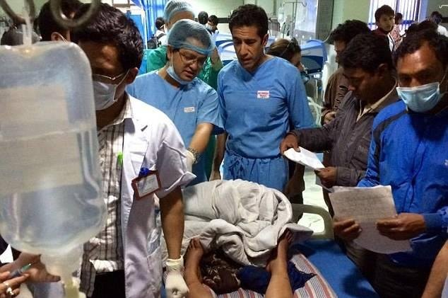 Dr. Sanjay Gupta, center, was on a reporting assignment before he was asked to perform brain surgery on an eight-year-old victim of the earthquake in Nepal. Photo Courtesy of Karuna Bhandari/Facebook