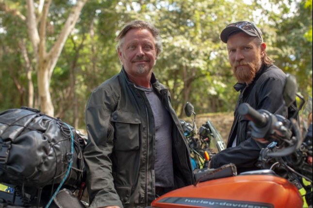Charley Boorman (L) and Ewan McGregor ride Harley-Davidson electric LiveWires in Long Way Up. Photo courtesy of Apple TV+