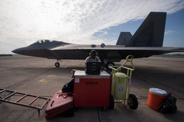 An F-22 Raptor stealth fighter plane sits at Joint Base Hickam-Pearl Harbor, Hawaii. F-22s are assembled in the Western Pacific Ocean for Operation Pacific Iron, and exercise, which some regard as a show of force against China. Photo by TSgt. Jason Robertson/U.S. Air Force
