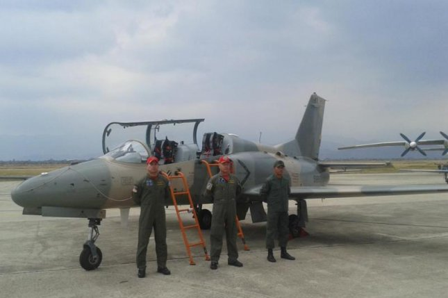 Venezuelan Air Force pilots with a newly acquired Chinese-made trainer/light attack jet. Photo courtesy Venezuelan Air Force