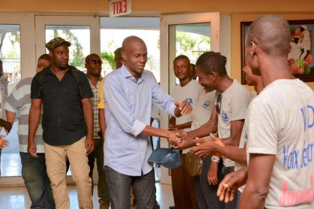 Haitian President-elect Jovenel Moïse, seen here shaking hands with supporters, said he was questioned by a judge investigating accusations of money laundering and special treatment in loans for four hours. He is set to be sworn in on Feb. 7. Photo courtesy of Jovenel Moïse
