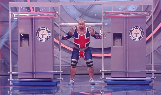 Hafthor Bjornsson, known for his role as The Mountain on Game of Thrones set a Guinness World Record by carrying two refrigerators, totaling 992 pounds, 65 feet in 19.6 seconds.  Photo by Guinness World Records/YouTube