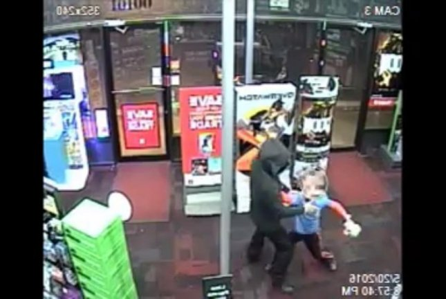 The hero that Game Stop deserves faces off against an armed robber in Silver Spring, Md. Screenshot: mcpdmedia/YouTube