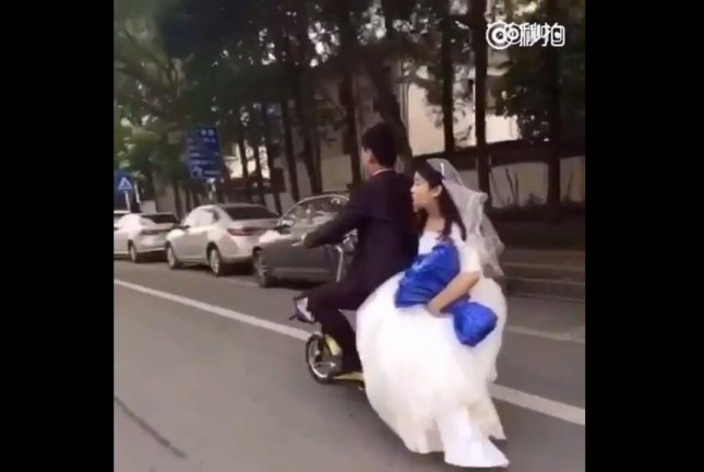 These newlyweds' marriage is about to hit its first major bump in the road. Screenshot: People's Daily, China/Facebook