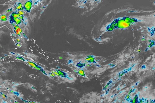 Satellite images on Friday morning showed an area of showers and thunderstorms beginning to become better organized with a notable swirl of low pressure. Image courtesy of NOAA