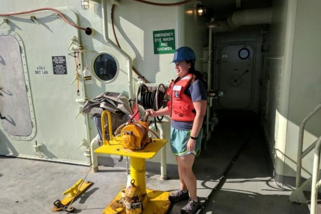 Researcher ElizabethTrembath-Reichert is pictured operating the winch for the CTD water sampler, which was used to pump fluids back up to the research vessel from the Atlantic seafloor. Photo by Ben Tully