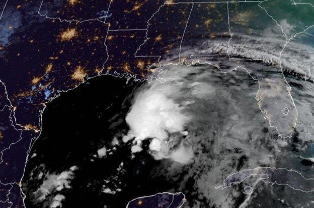 This is a satellite image taken Friday of the system in the Gulf of Mexico that could become Tropical Storm Claudette later in the day. Photo courtesy of the National Oceanic and Atmospheric Administration