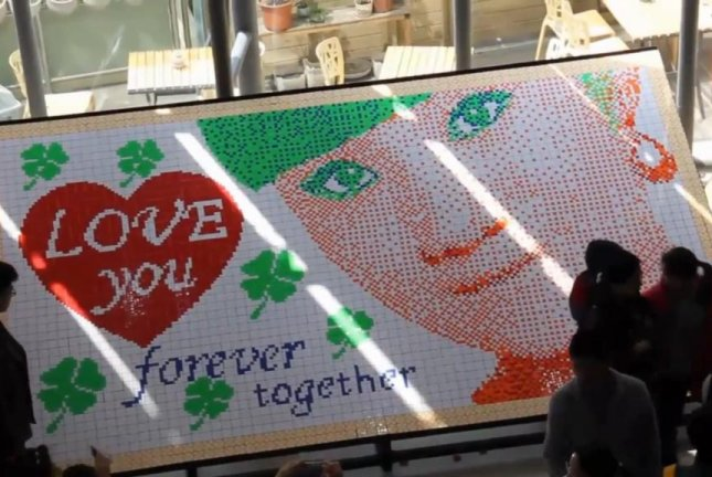 Watch Rubiks Cubes Form Womans Face Message Of Love Upi