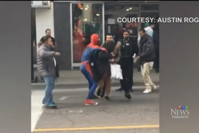 A man dressed as Spider-Man holds a shoplifting suspect in downtown Toronto. Screenshot: CTV Toronto/YouTube