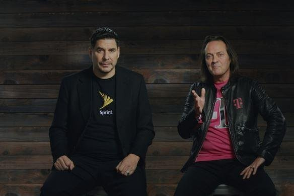 The two leaders of cellphone providers -- Sprint's Marcelo Claure (L) and T-Mobile John Legere -- announce a merger valued at $146 billion. Photo courtesy of T-Mobile