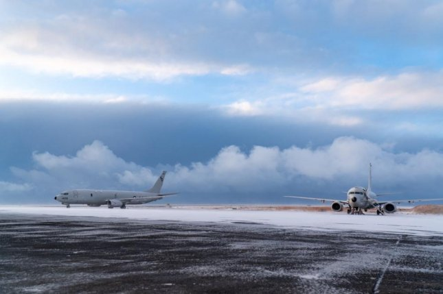 Two P-8A Poseidon maritime patrol and reconnaissance aircraft assigned to Patrol Squadron 4 are parked on the apron of Keflavik Air Base in January. Photo by Amariv Perez/U.S. Air Force