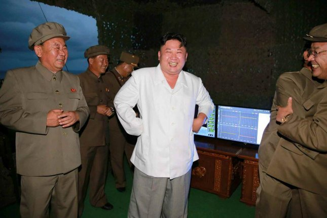 North Korea's Kim Jong Un celebrating Pyongyang's Wednesday SLBM launch, according to state media. Kim is planning to bring more powerful submarines into production so multiple rounds of missiles can be launched, Japan press reported Friday. File Photo by Rodong Sinmun