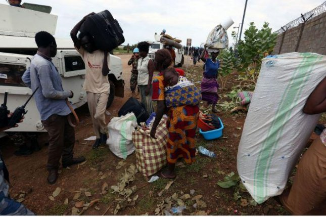 Refugees at the United Nations mission in Juba, South Sudan, pack up their belongings after several days of violence. Photo by Eric Kanalstein/United Nations Mission in South Sudan