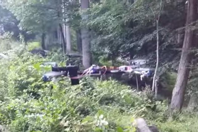 A handgun mounted to a homemade aerial drone fires four shots in a wooded area. Hogwit/YouTube video screenshot