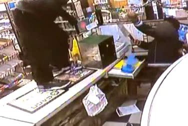 A Falls River, Mass., store owner armed himself with a knife to defend against a knife-wielding robber. Neither man was injured in the ensuing fight. CBS Boston video screenshot