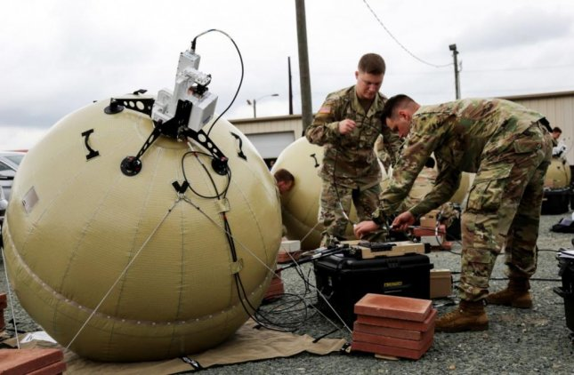 Soldiers prepare an inflatable satellite communications system, one of the elements involved in the U.S. Army's Project Convergence, an exercise to unite modern warfighting methods underway at the Yuma Proving Grounds, Ariz. Photo courtesy of U.S. Army