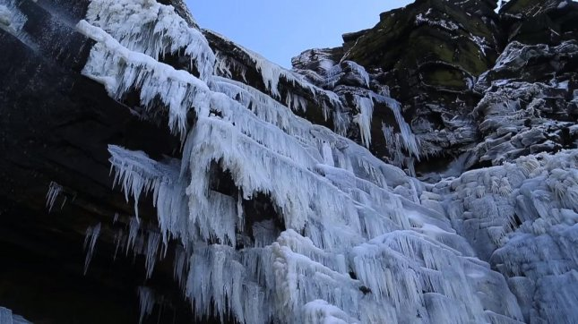 The Kinder Downfall waterfall near Hayfield, England, was frozen solid Wednesday morning. Newsflare video screenshot