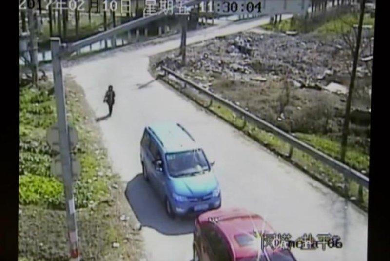 A driver shoots a singshot at a traffic camera. Screenshot: Newsflare