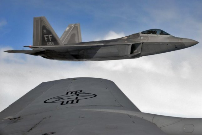A U.S. Air Force F-22 Raptor flies alongside a U.S. Air Force KC-135 Stratotanker from RAF Mildenhall, England, Oct. 13, over Germany. The U.S. Air Force deployed 12 F-22 Raptors to RAF Lakenheath, to participate in training exercises with NATO allies. Photo by Airman 1st Class Luke Milano/U.S. Air Force