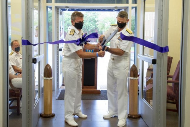 Royal Navy Rear Adm. Andrew Betton, deputy commander of Joint Force Command Norfolk, (left) and U.S. Vice Adm. Andrew Lewis, commander of the command, cut the ribbon during an Initial Operational Capability ceremony on Thursday. Photo by Mass Communication Specialist 1st Class Theodore Green/U.S. Navy