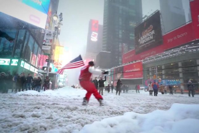 A man snowboards through New York's Times Square. Casey Neistat/Facebook video screenshot