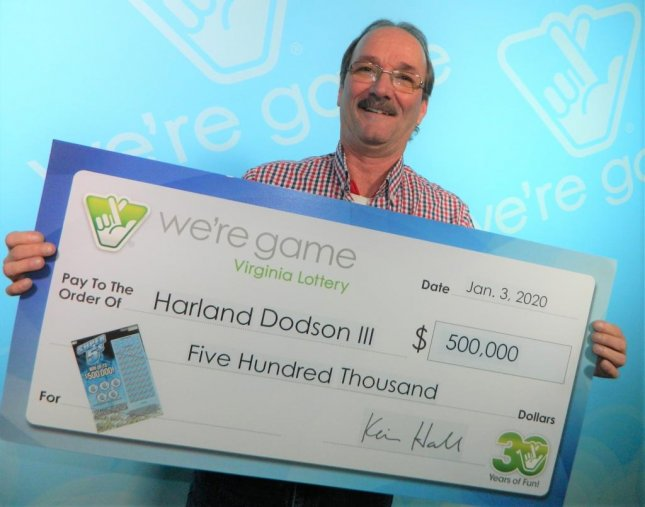 A Virginia man said running an errand to buy his wife a lighter paid off with a $500,000 lottery jackpot. Photo courtesy of the Virginia Lottery