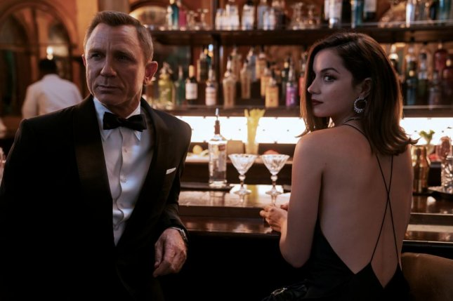 Daniel Craig as James Bond (L) and Ana de Armas as Paloma in No Time to Die. Photo courtesy of MGM