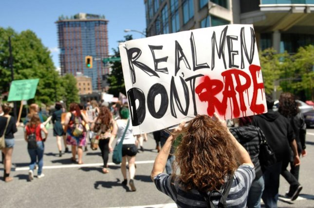 Hundreds of women and men marched the streets of downtown Vancouver, Canada, to protest against sexual assault. In a Gallup poll study, 34 percent of American women say they worry frequently or occasionally about being sexually assaulted. File photo by Sergei Bachlakov/Shutterstock