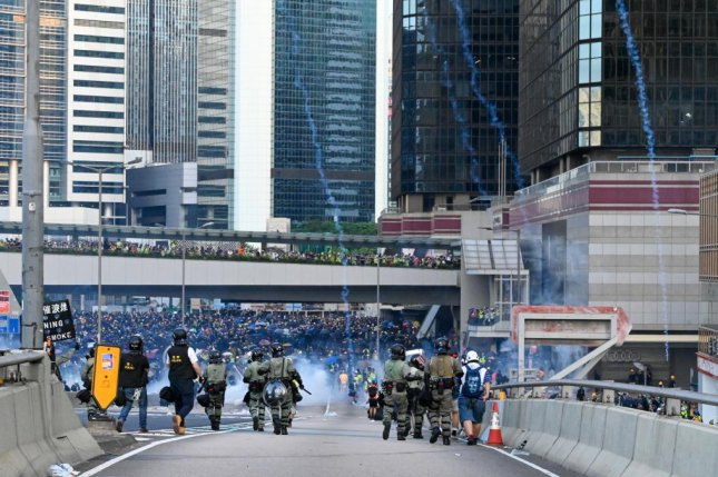 Tear gas canisters come raining down as a standoff between riot police and protesters escalated on Sunday in Hong Kong. Photo by Thomas Maresca/UPI