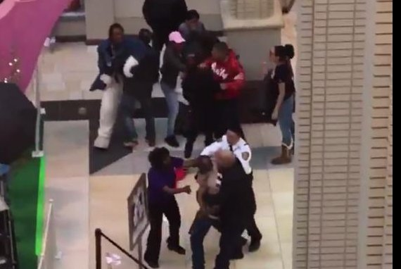 An Easter bunny is pulled away from the shopper he was fighting at a New Jersey mall. Screenshot: WPIX-TV