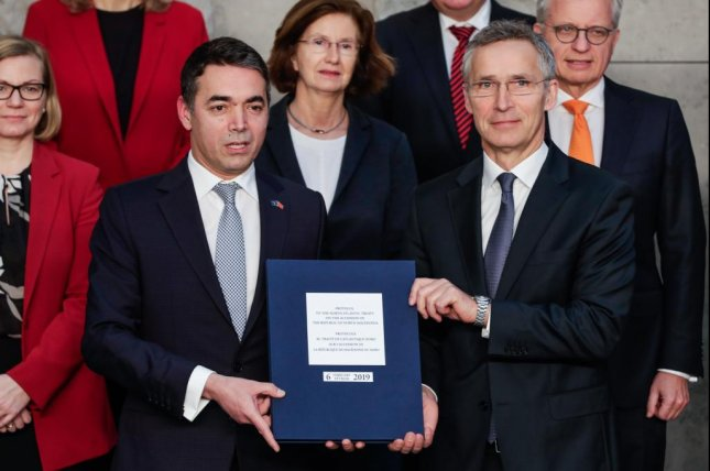 Macedonia Foreign Minister Nikola Dimitrov (L) and NATO Secretary General Jens Stoltenberg pose Tuesday after a signing ceremony of the Accession Protocol with Skopje at NATO headquarters in Brussels, Belgium. Photo by Stephanie Lecocq/EPA-EFE