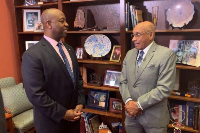South Carolina Sen. Tim Scott meets with former NHL player Willie O'Ree in Washington, D.C., Thursday. O'Ree became the first black NHL player in 1958. Photo by Medill News Service