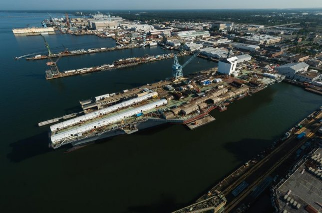 The aircraft carrier John F. Kennedy, approximately percent complete and is progressing through final outfitting and testing, sits at Pier 3 at Newport News Shipbuilding division. Photo by Matt Hildreth/HII