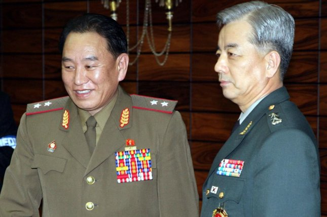 Kim Yong Chol (L), the North Korean vice chairman of the ruling Workers' Party Central Committee, visiting with South Korea's Han Min-koo in March 2006. Kim is attending the Winter Olympics closing ceremony on Sunday. File Photo by Yonhap