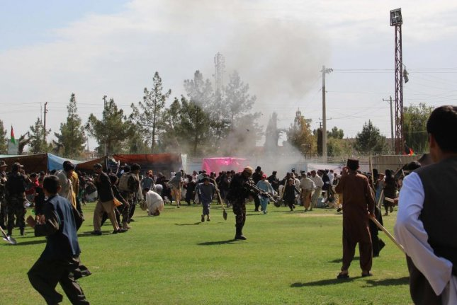 People react after twin bomb blasts targeting the Farmers Day ceremony attended by the Governor of Helmand province, in Helmand on Saturday. According to reports at least three people were killed and more than 30 others were wounded. Photo EPA-EFE/Watan Yar