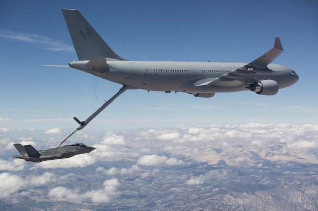An Airbus A330 refuels a jet fighter. Photo courtesy of Airbus