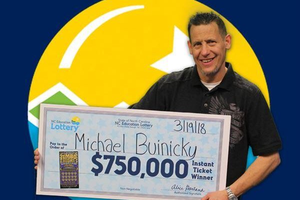 Look: North Carolina man claims second big lotto prize in