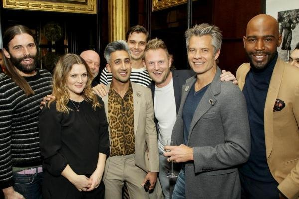 The stars of Queer Eye -- left to right, Jonathan Van Ness, Tan France, Antoni Porowski, Bobby Berk and Karamo Brown -- pose with Drew Barrymore and Timothy Olyphant from Santa Clarita Diet at a Netflix cocktail party in New York on Jan. 30. Queer Eye was renewed for a third season Friday. File Photo courtesy of Netflix