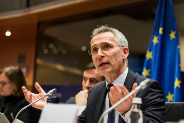 NATO Secretary-General Jens Stoltenberg, pictured addressing the European Parliament last week, called for a global NATO approach in remarks on Wednesday. Photo courtesy of NATO