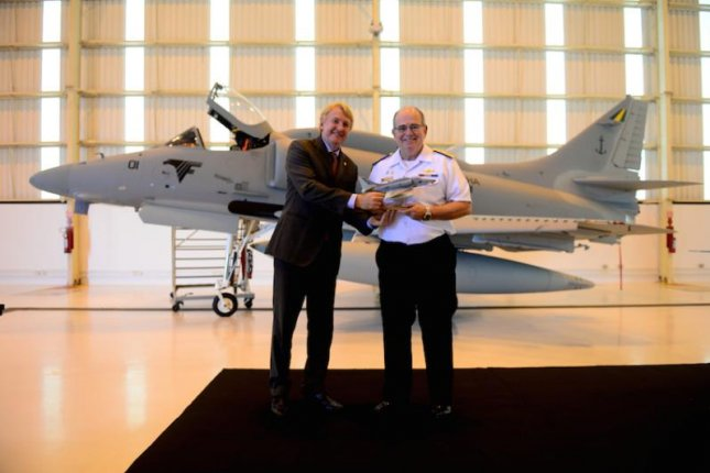 Embraer Defense & Security president Jackson Schneider officially delivers a model of the first modernized Skyhawk aircraft to Admiral Eduardo Bacellar Leal Ferreira, commander of the Brazilian Navy. Photo courtesy Embraer
