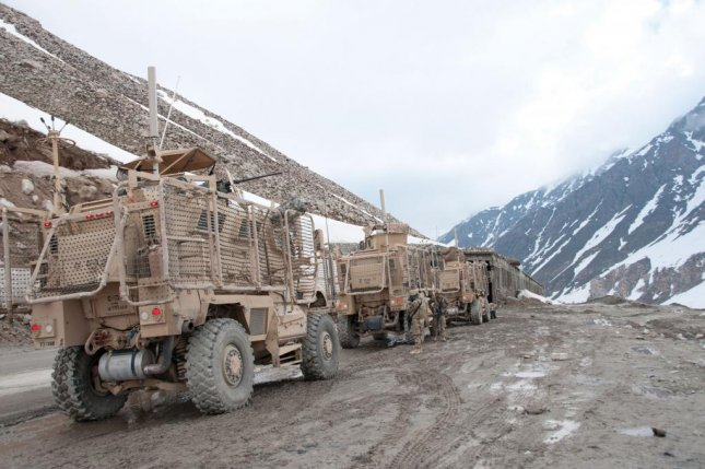 The U.K. Ministry of Defense announced a partnership with the Pentagon Thursday to explore robotic resupply systems for challenging environments. Pictured, U.S. Army transport soldiers pause during a convoy in northeastern Afghanistan in 2014. U.S. Army photo by Sgt. 1st Class Luis Saavedra