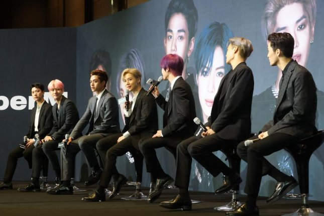 Seven-member South Korean boy band SuperM poses for a photo during a showcase for its debut at the Seoul Dragon City hotel in Seoul on October 2. Photo by Yonhap
