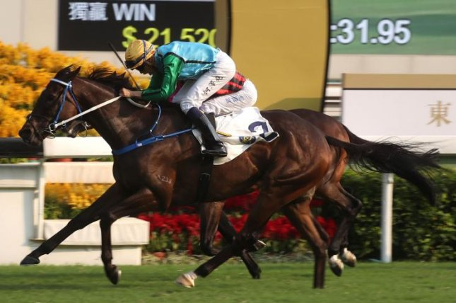 Rise High (No. 2) wins Sunday's Oriental Watch Sha Tin Trophy in Hong Kong, denying Beauty Generation an 11th straight win. Photo courtesy of Hong Kong Jockey Club