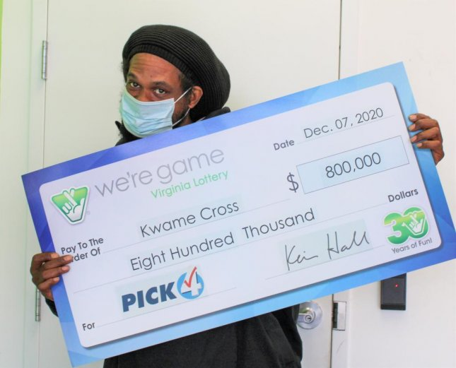 Kwame Cross of Dumfries, Va., said he had a lucky feeling about a set of numbers he copied down from a TV show so he bought 160 tickets bearing those digits for a single Pick 4 drawing -- and won 160 times. Photo courtesy of the Virginia Lottery